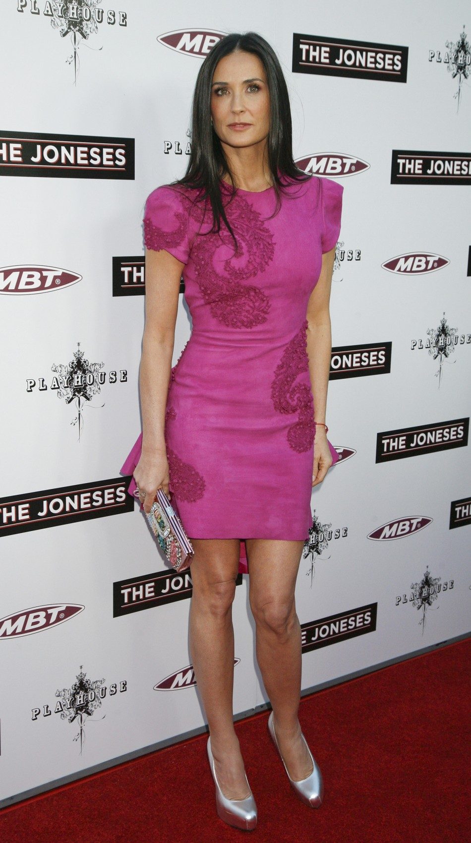 """Actress Demi Moore, cast member of the movie """"The Joneses"""", arrives for the film's premiere in Los Angeles"""