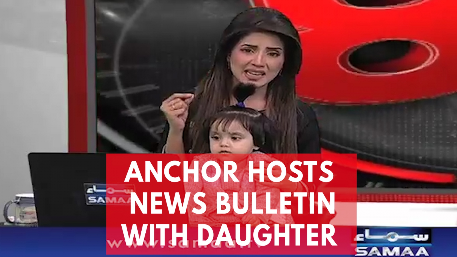 tv-anchor-presents-news-with-daughter-on-her-lap-to-protest-8-year-olds-rape-and-murder