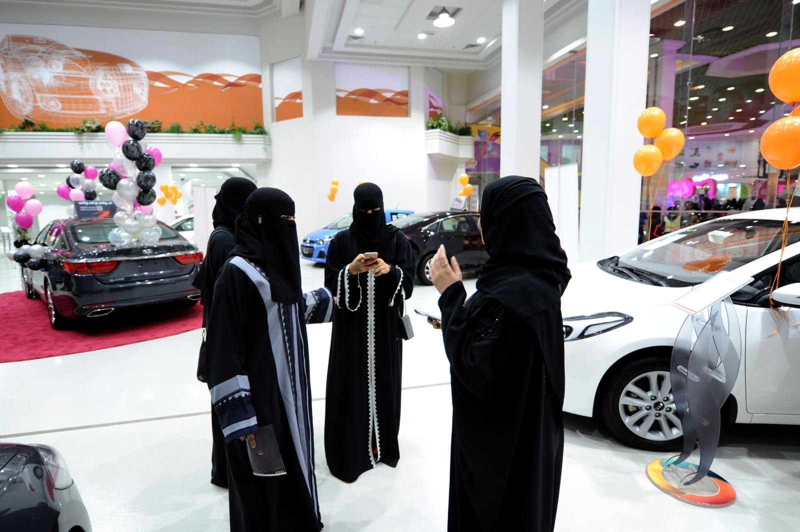 Saudi women tour a car showroom for women in the Red Sea port city of Jeddah