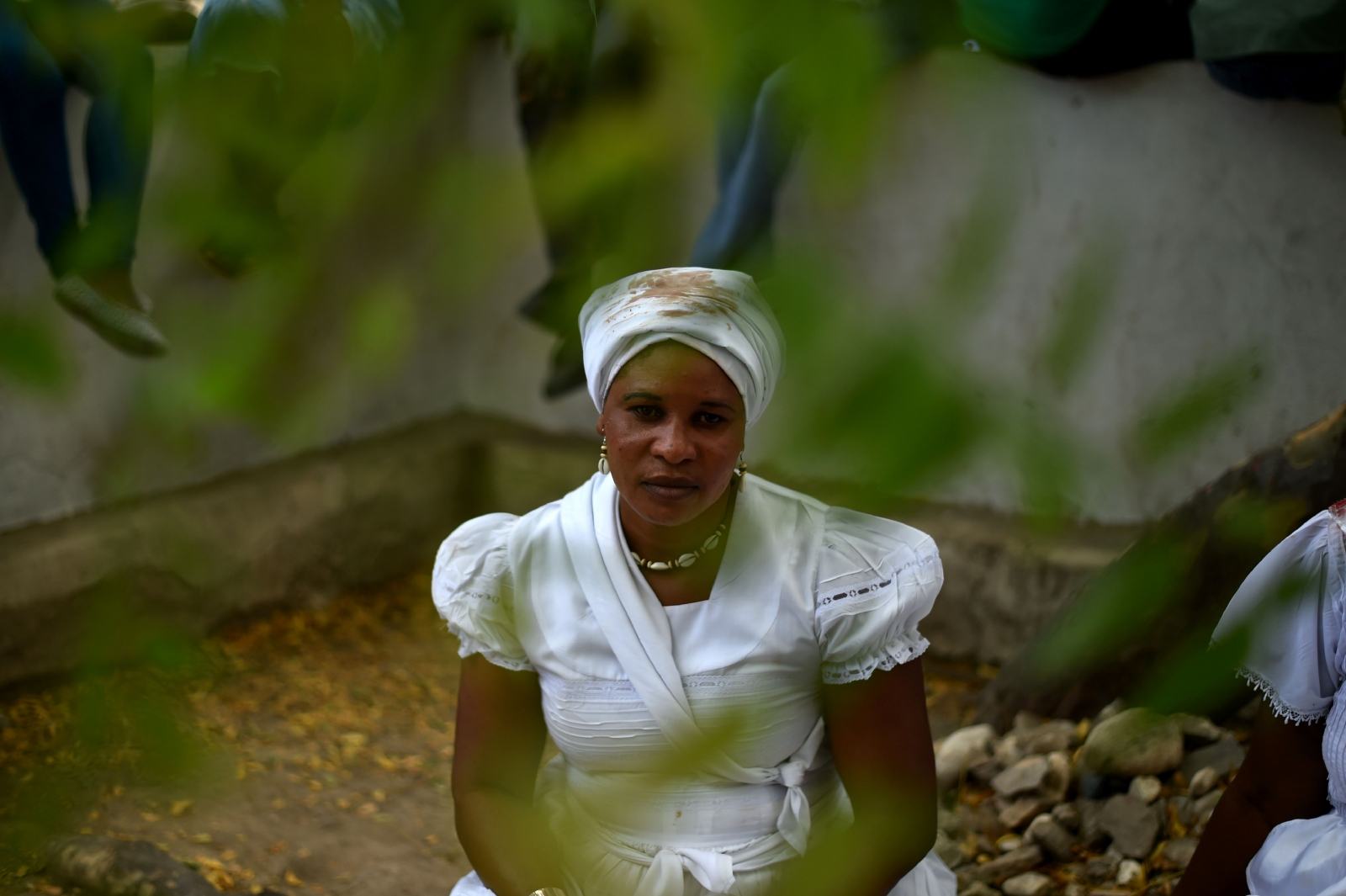 Haitian voodoo follower wearing white clothes