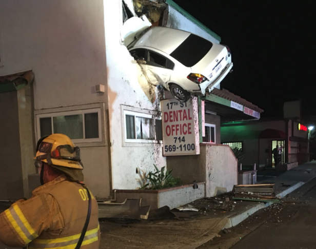 Orange County car crash into house