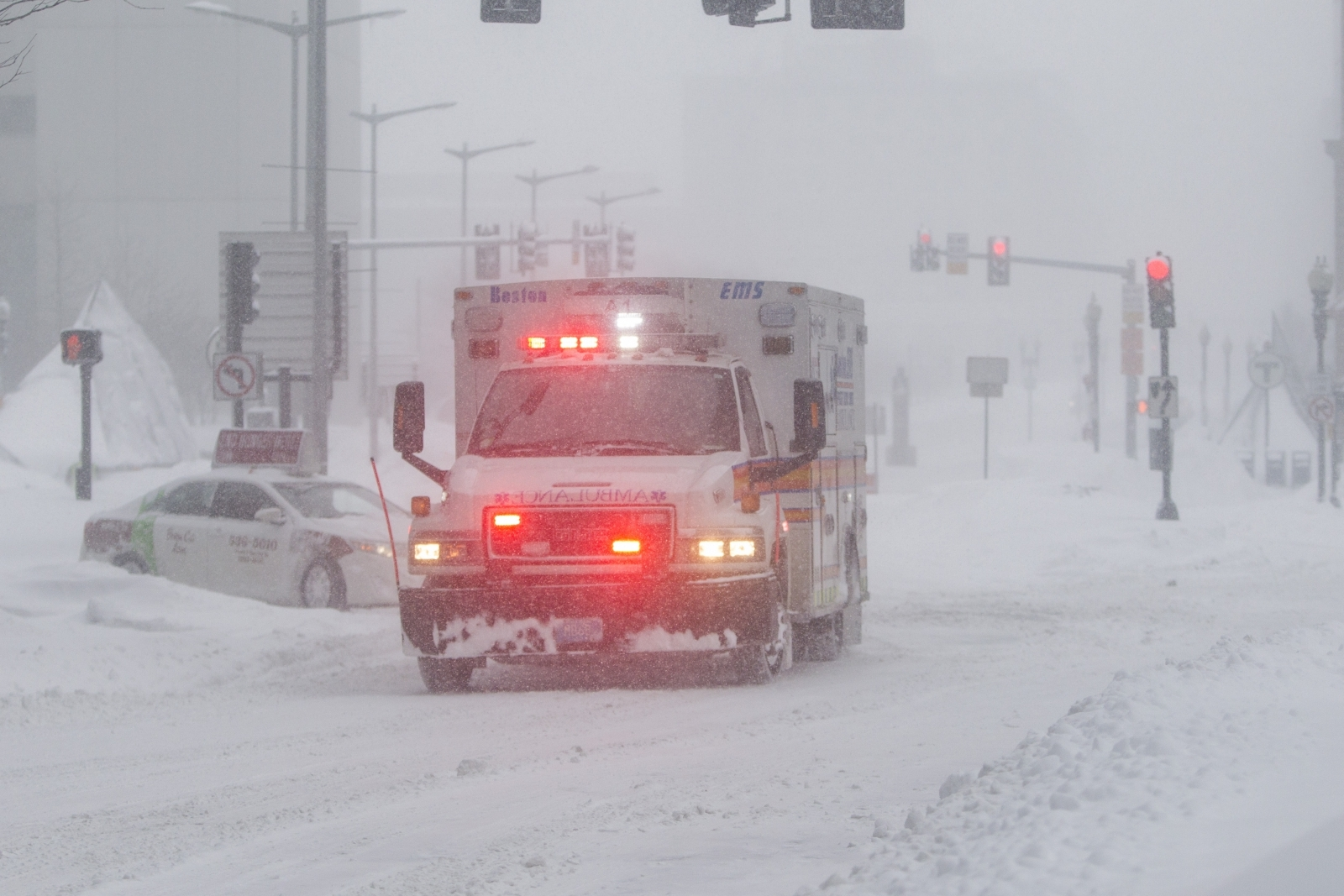 Video of passers-by helping tow ambulance on snow-covered street goes viral
