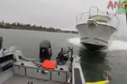 Fishermen leap overboard before being hit by oncoming boat