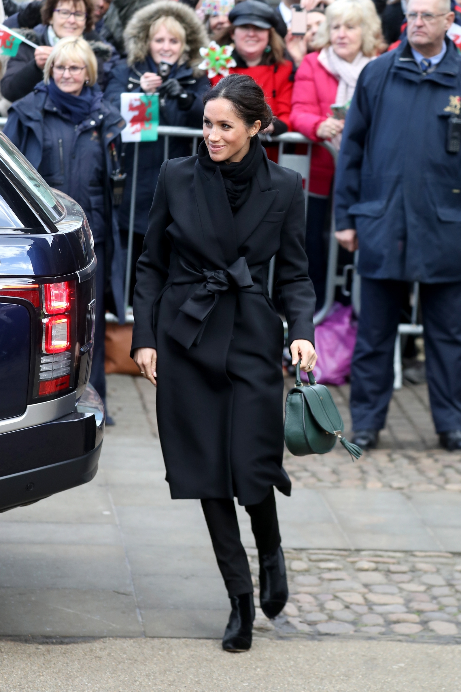 Meghan Markle stuns in £1,350 Stella McCartney wrap coat upon first visit to Wales with Prince Harry