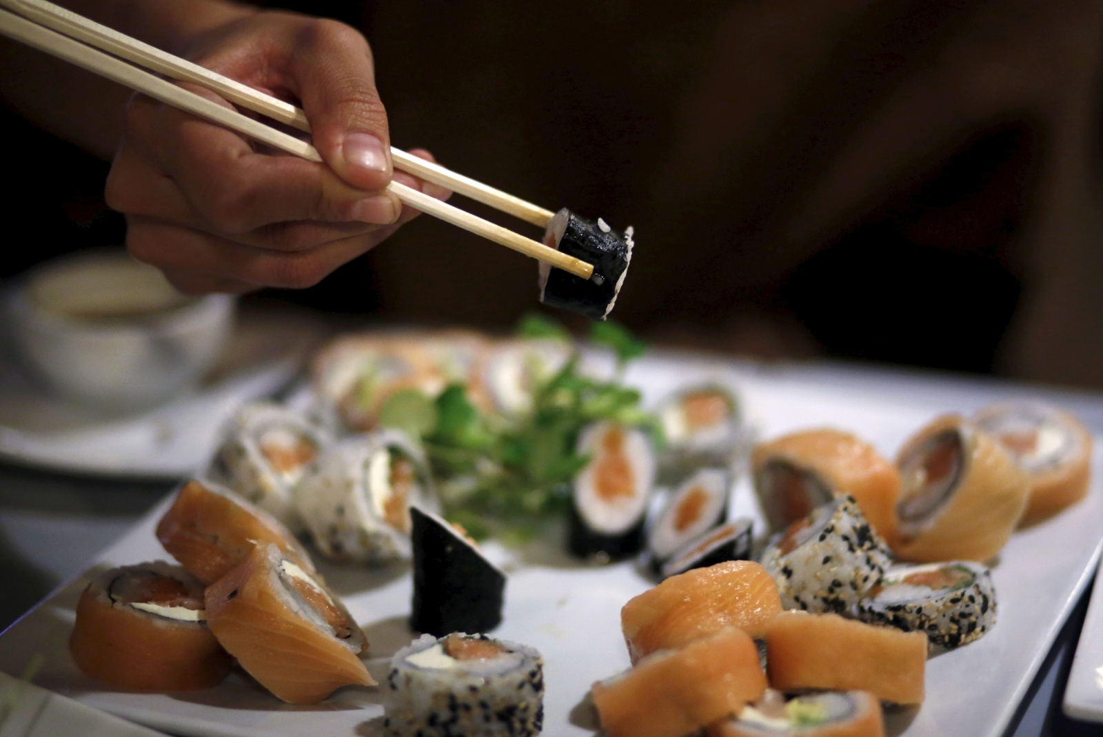 A 5-foot long tapeworm pulls out from a sushi lover's body