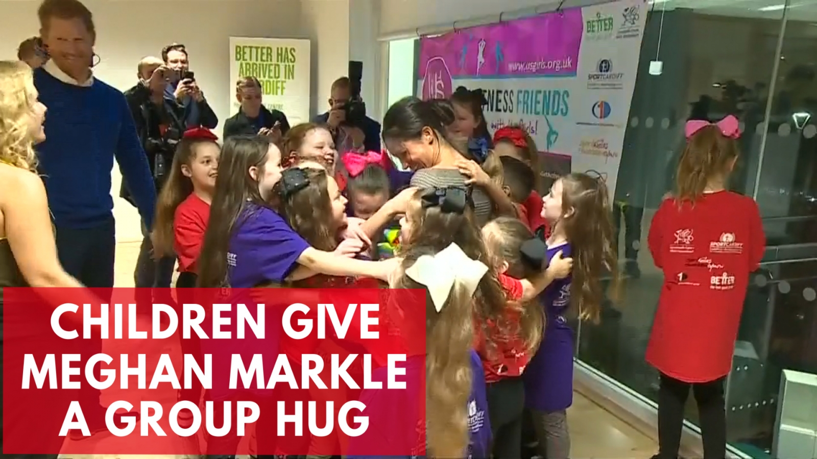 meghan-markle-receives-group-hug-from-school-children