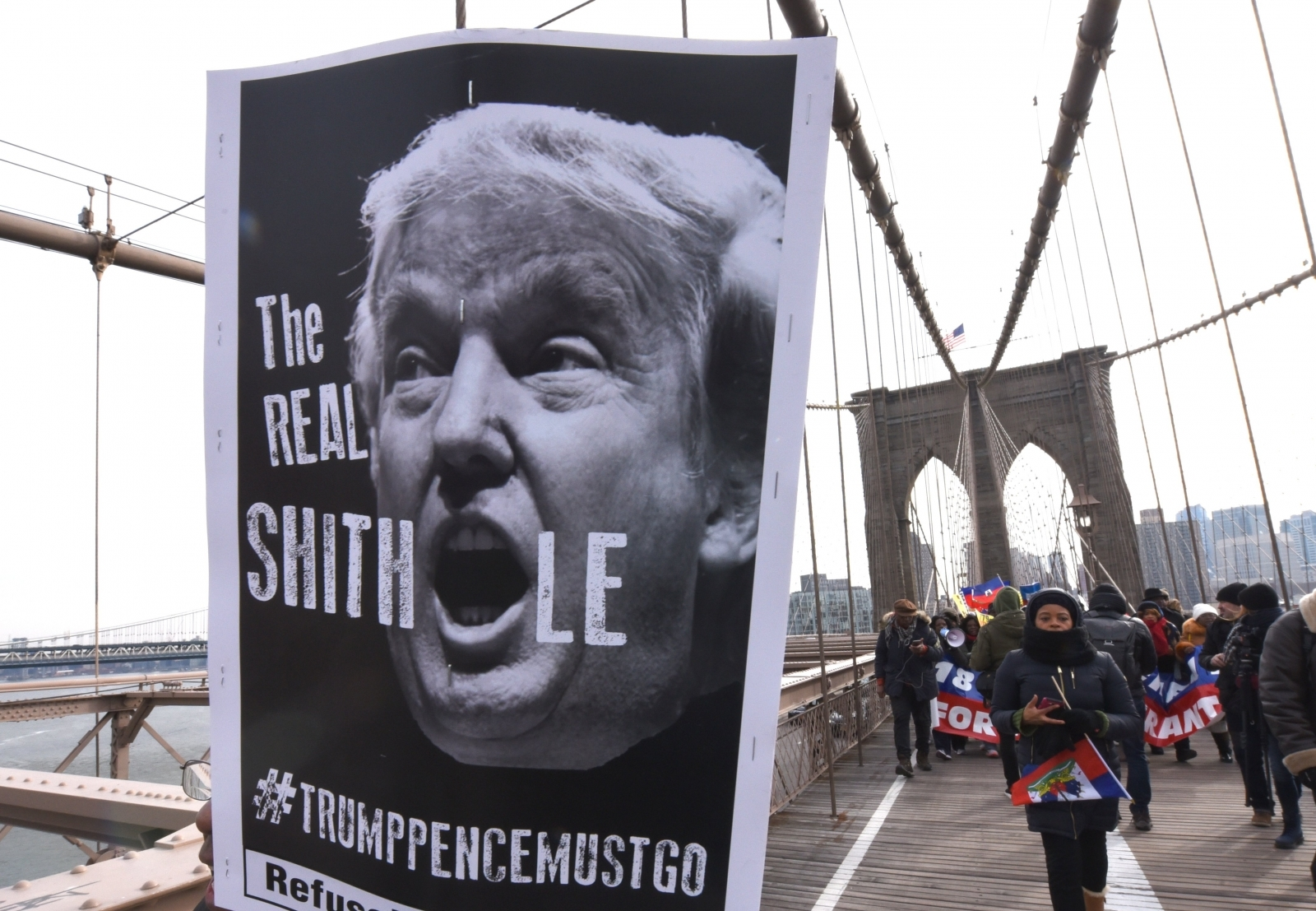 Protesters march across the Brooklyn Bridge over Trump's remarks, policies