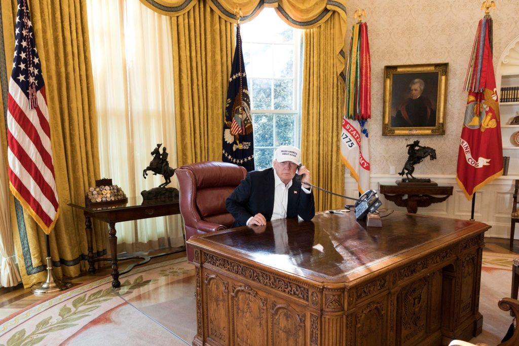 Donald Trump working Oval Office