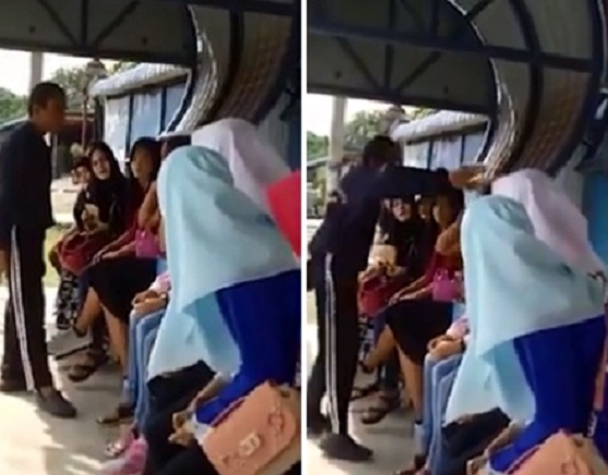 Woman slapped for not wearing hijab