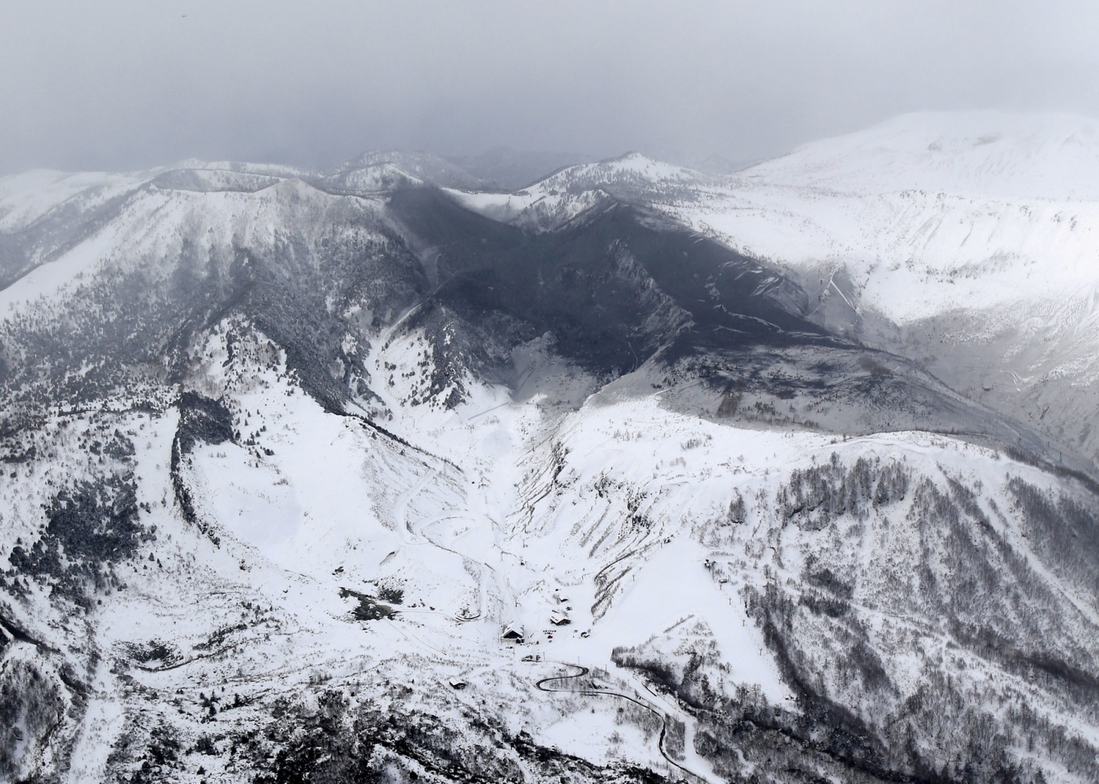 mount shirane volcano erupts in japan triggering avalanche as injuries feared