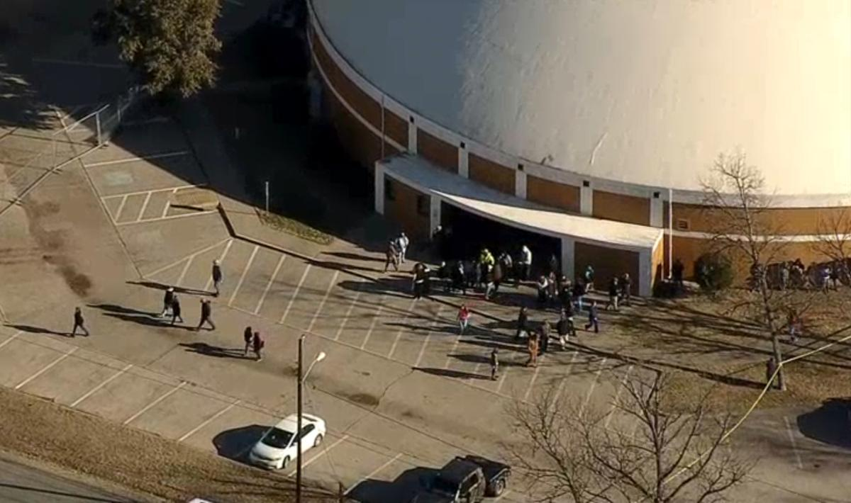 Students spill out of the Italy High School cafeteria where a teenage gunman shot the 15-year-old girl he recently broke up with