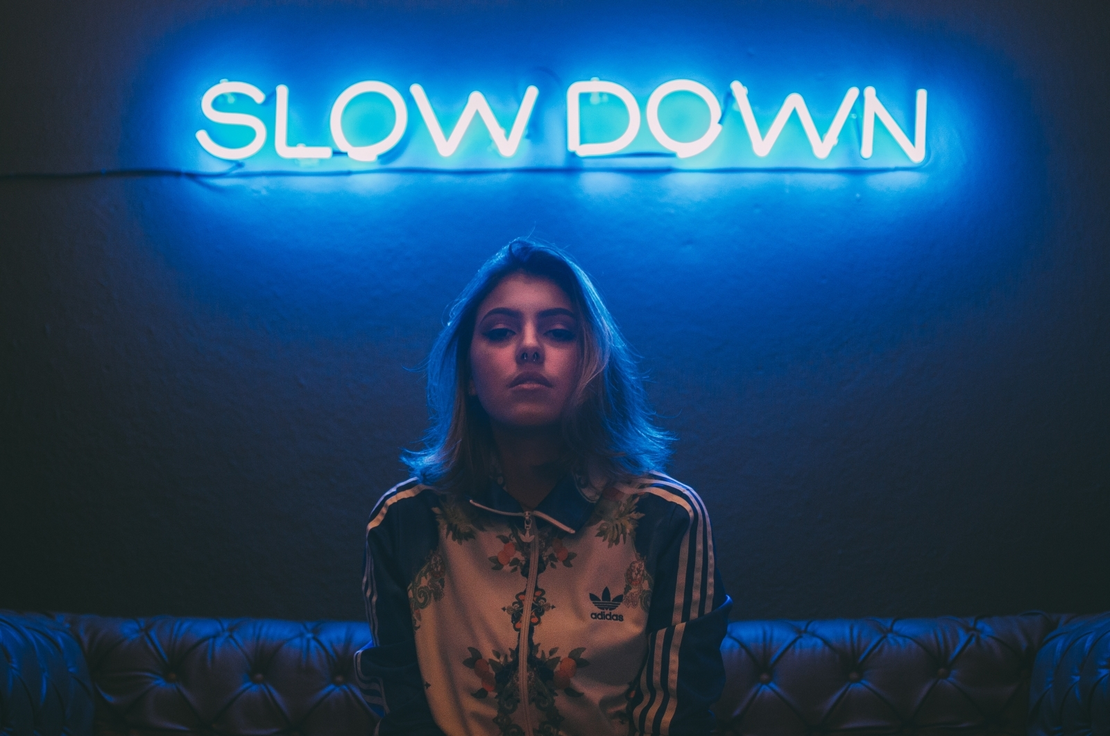 Woman in front of neon sign
