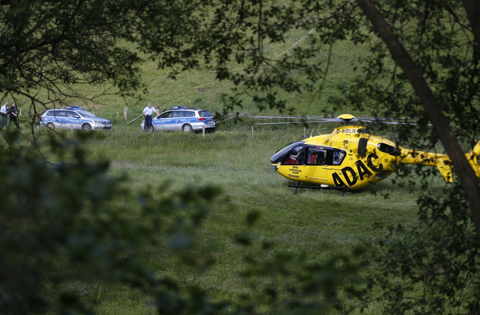 A German rescue helicopter collided in mid-air with a small plane killing four people