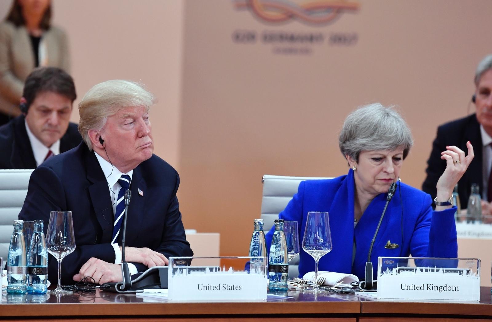 Donald Trump tells Theresa May he won't visit the UK unless she bans protests