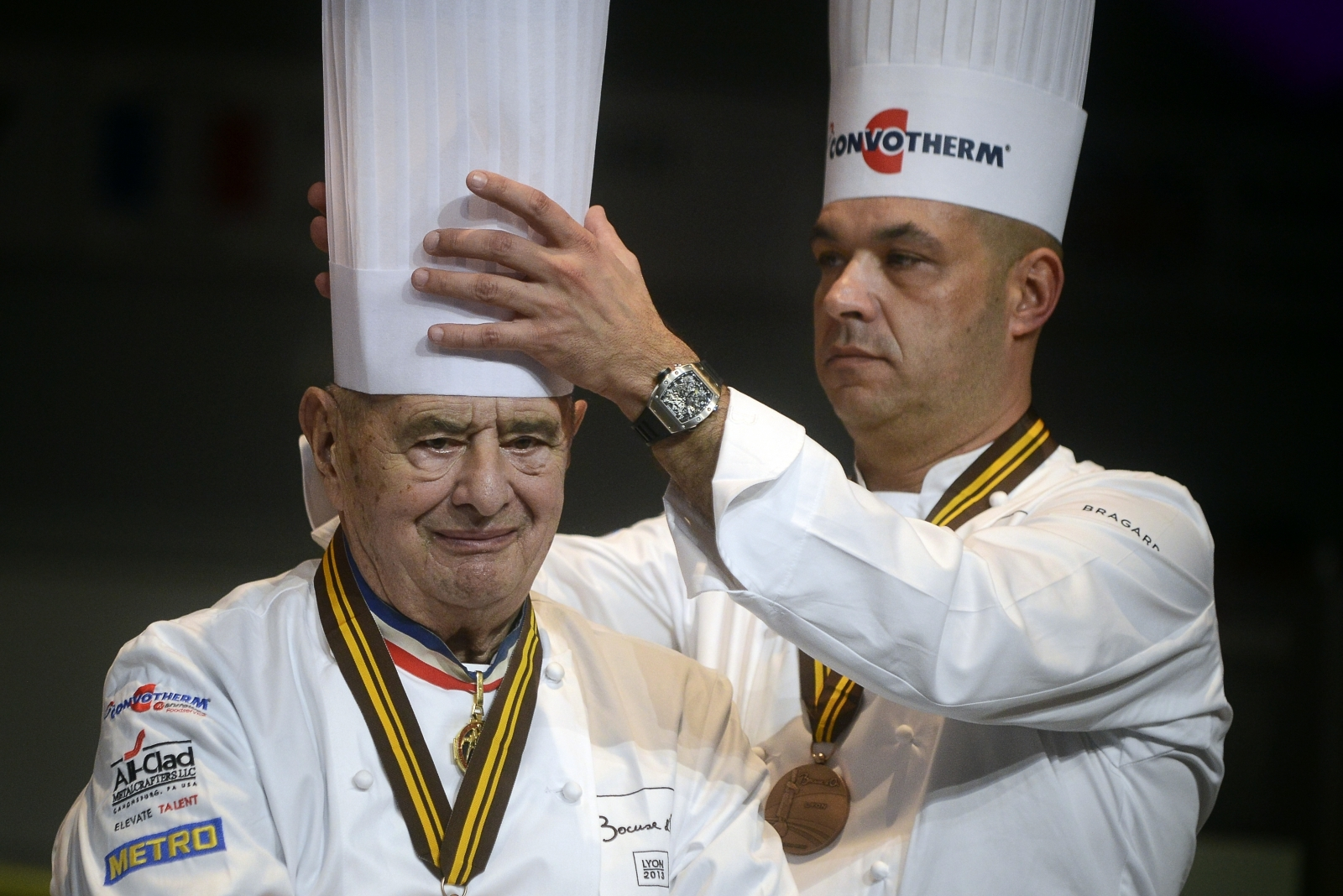 Hundreds of chefs from around the world, all in chef whites, attend Paul Bocuse's funeral in Lyon