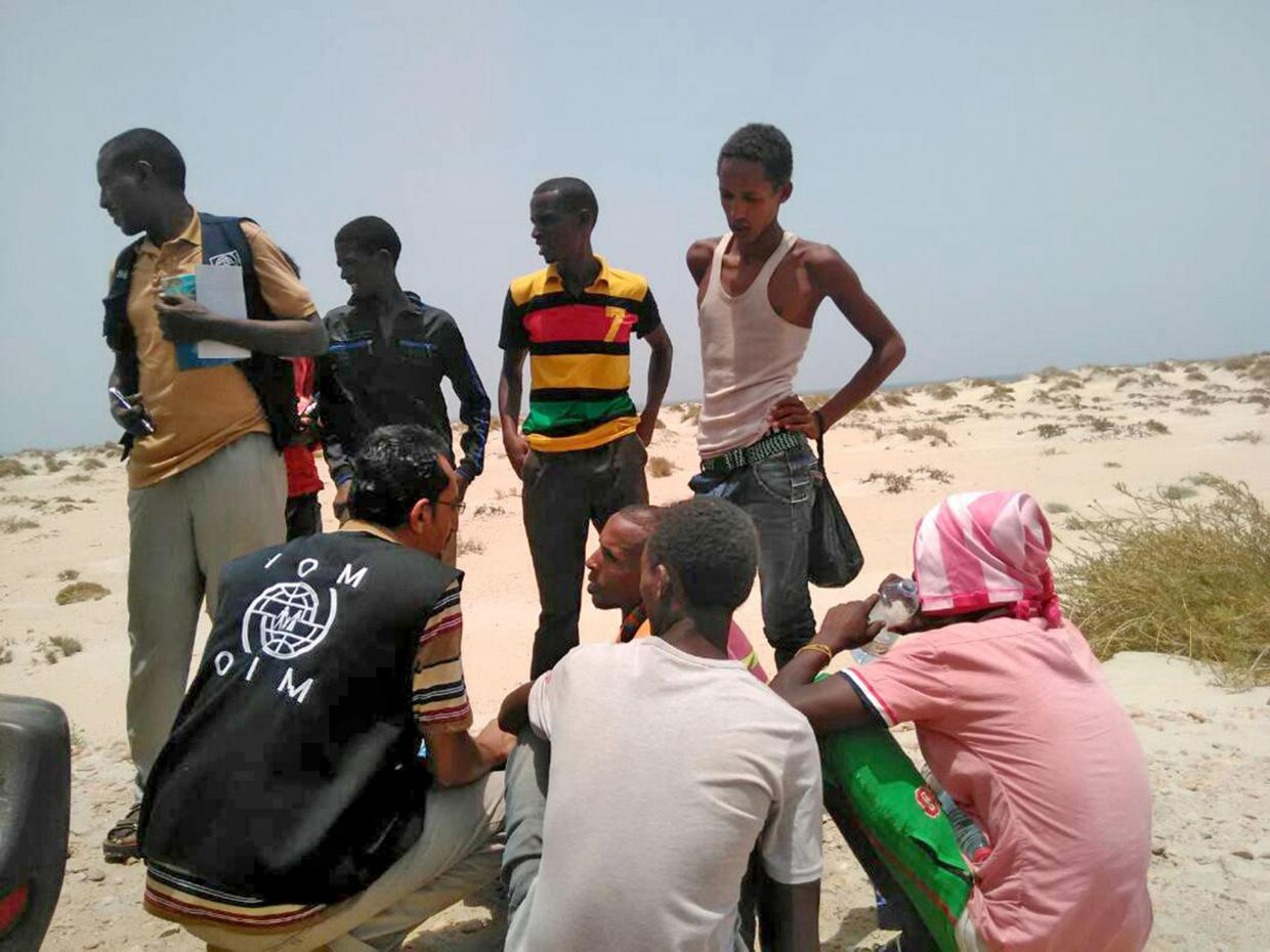 International Organisation for Migration staff help Ethiopian migrants forced into sea by smugglers last year