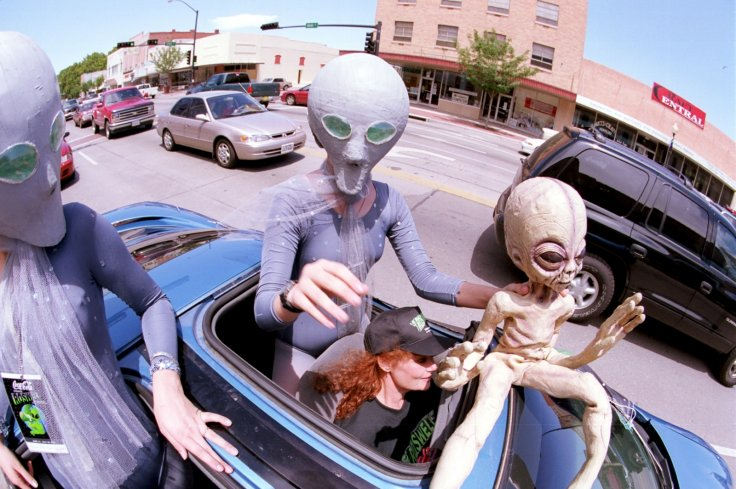 People dressed as aliens