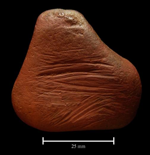 Ancient ochre pebble