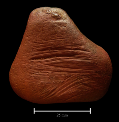 Ancient ochre pebble