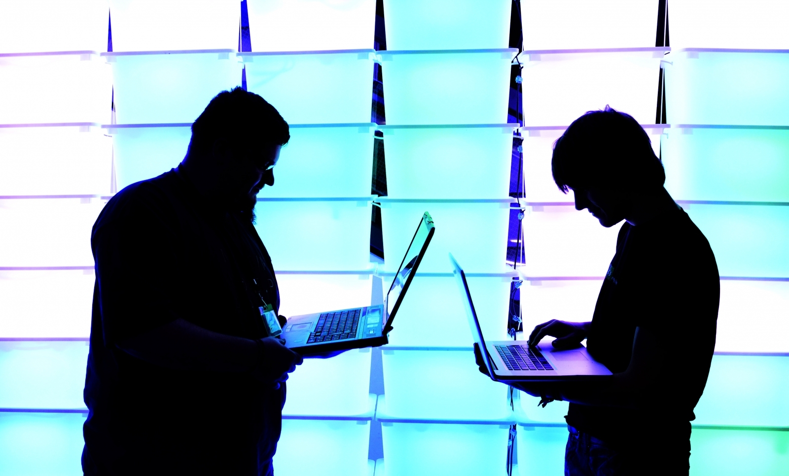 Men on laptops