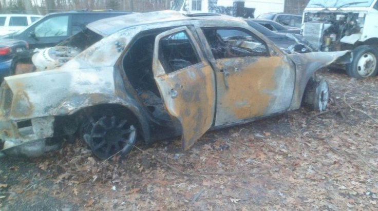 A photo of the wreckage of the burned car that an Oakland County Sheriff's deputy pulled a man from earlier this week