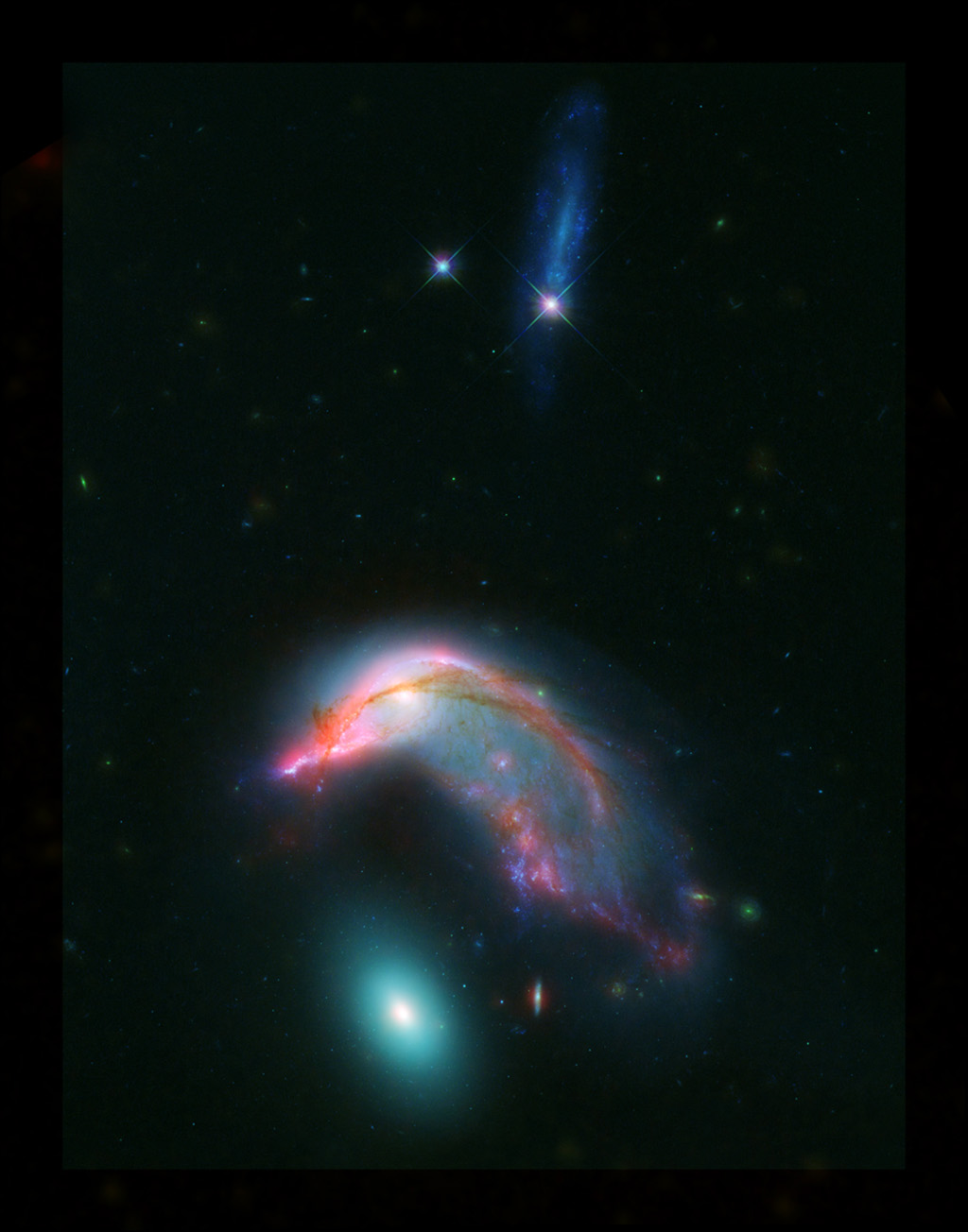 'Penguin guarding its egg': Hubble captures distant colliding galaxies in a breathtaking cosmic shot