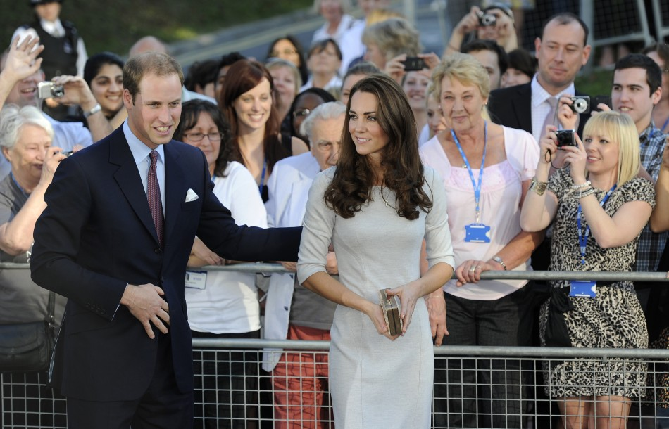 Britain's Prince William and his wife Catherine, Duchess of Cambridge leave after a visit to the Royal Marsden hospital in Sutton, southern England 29/09/2011