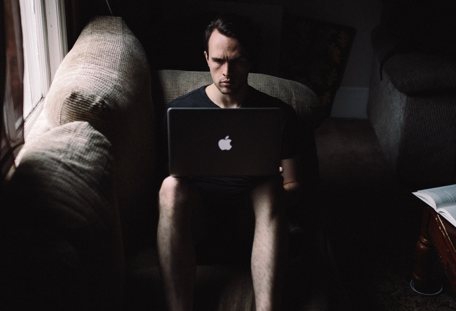 Man on a laptop in the dark