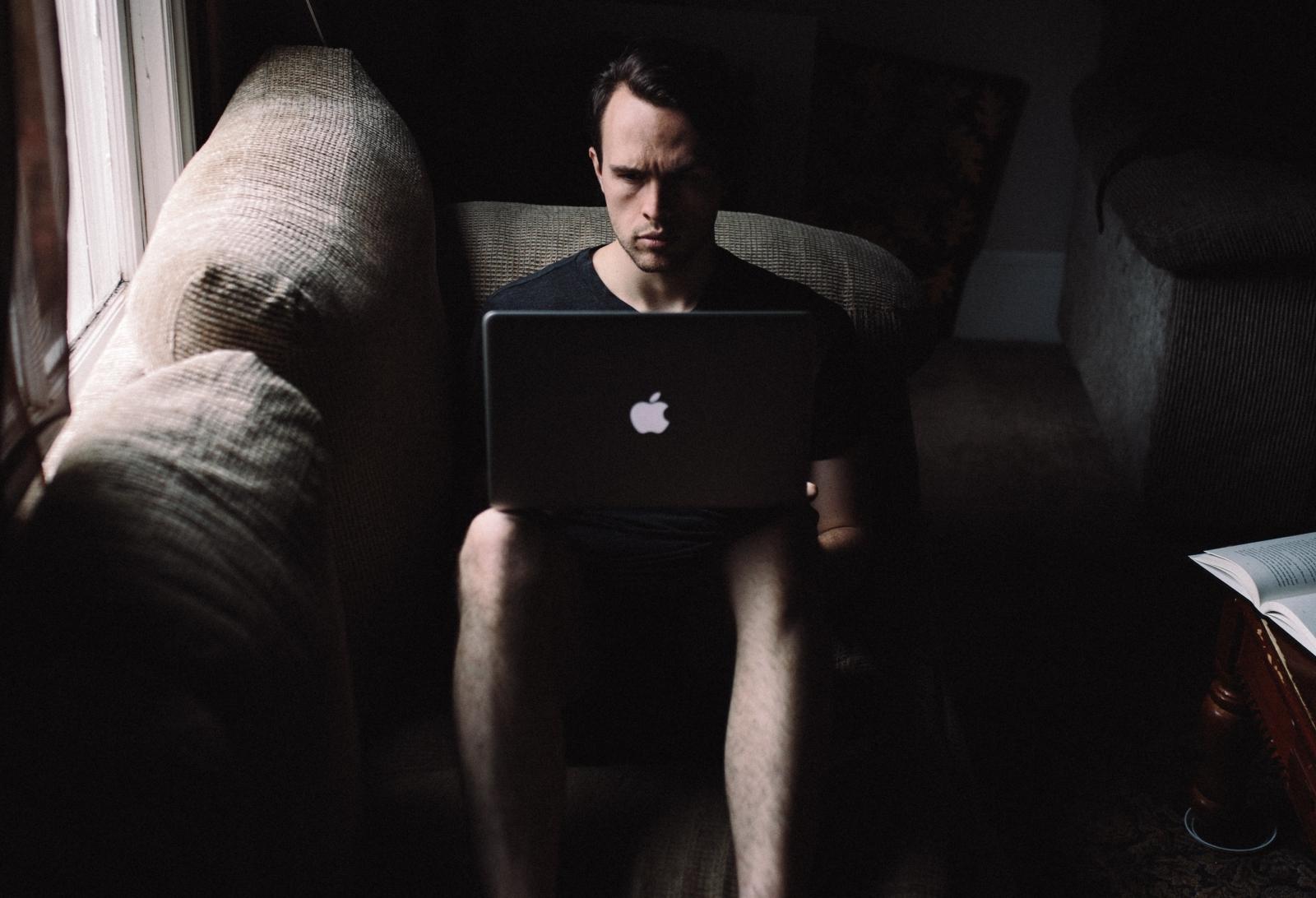 Man on a laptop in the dark