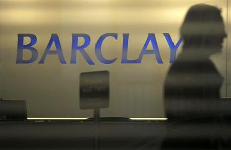 A customer enters a branch of Barclays bank in London