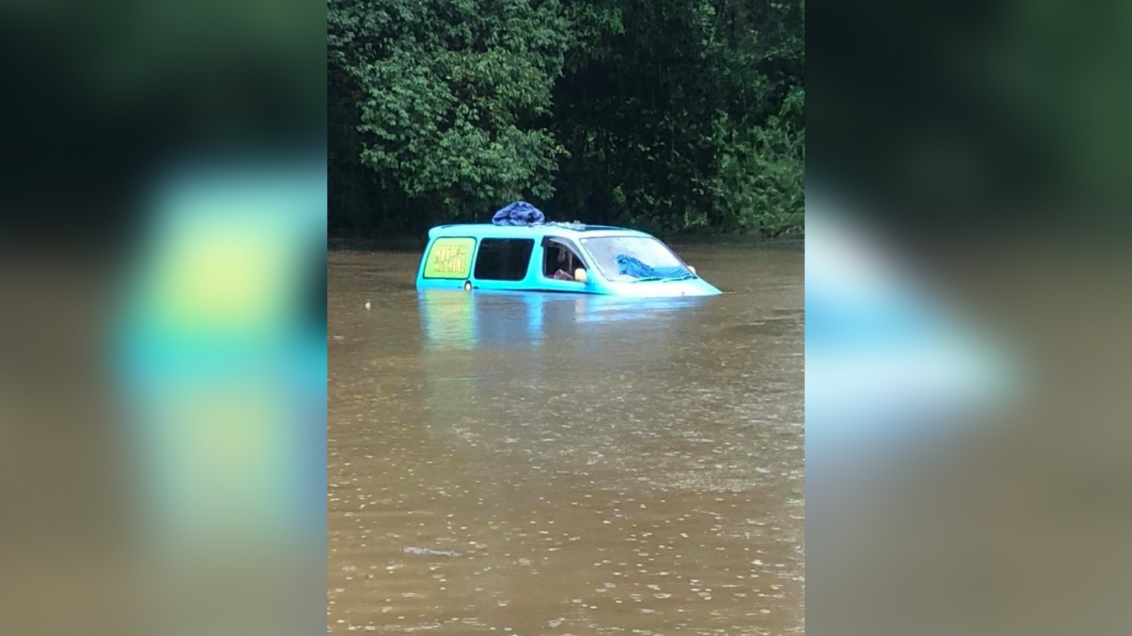 british-backpackers-wake-up-to-find-van-partially-submerged-by-floodwaters