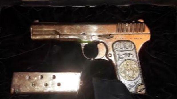 Gold-plated gun