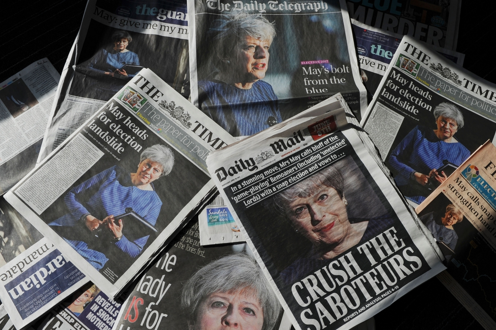 Theresa May announces review into future of print journalism