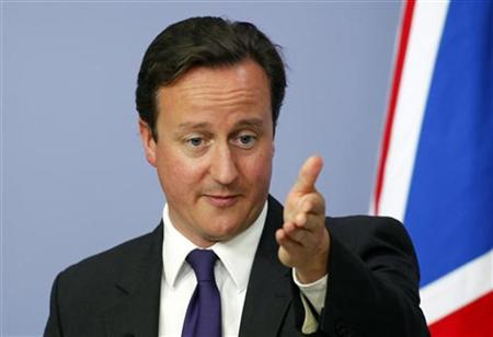 Prime Minister David Cameron gestures as he addresses the media in Ankara
