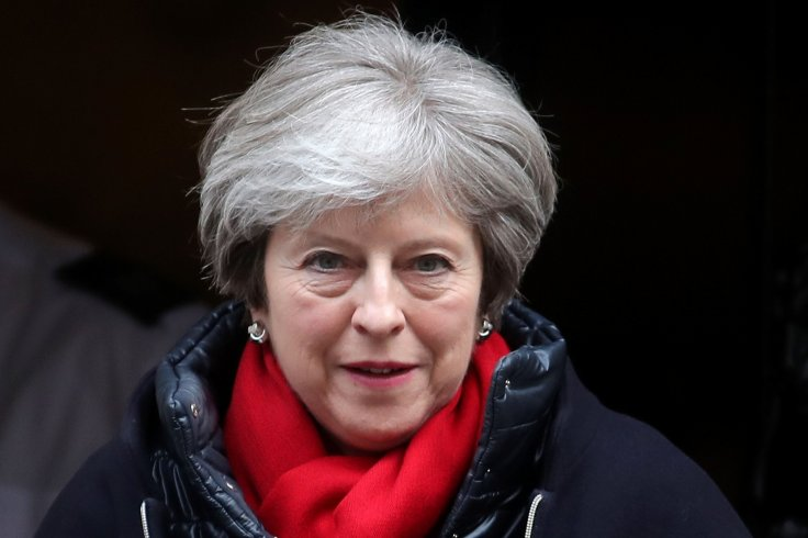 Theresa May leaves Downing Street for PMQs