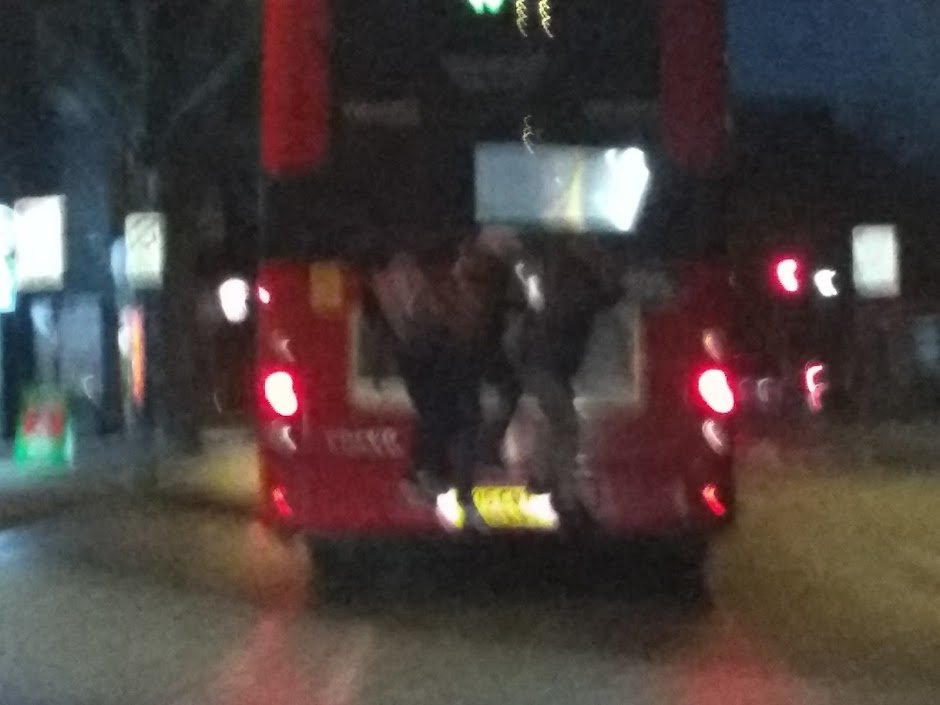 Teens on back of bus