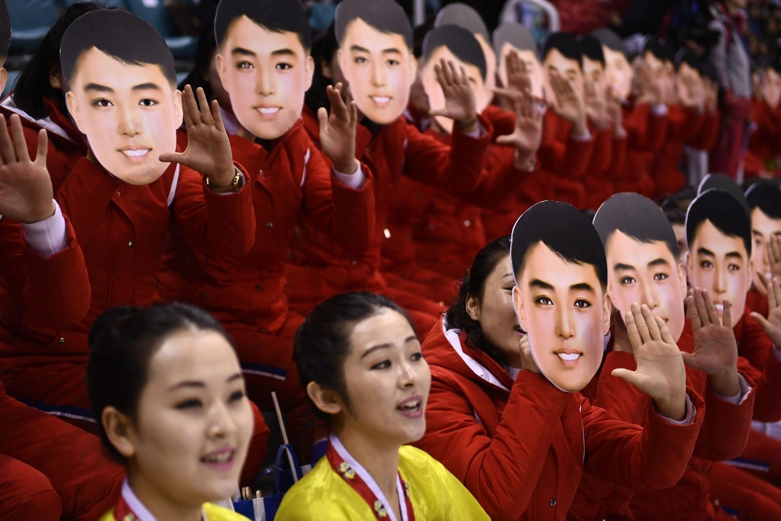 North Korean cheerleaders wearing Kim Il-sung masks