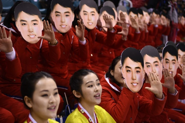 North Korean cheerleaders wearing Kim Il-sung masks