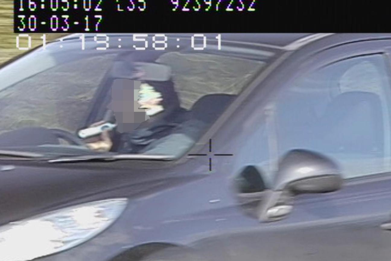 Man brushing teeth while driving