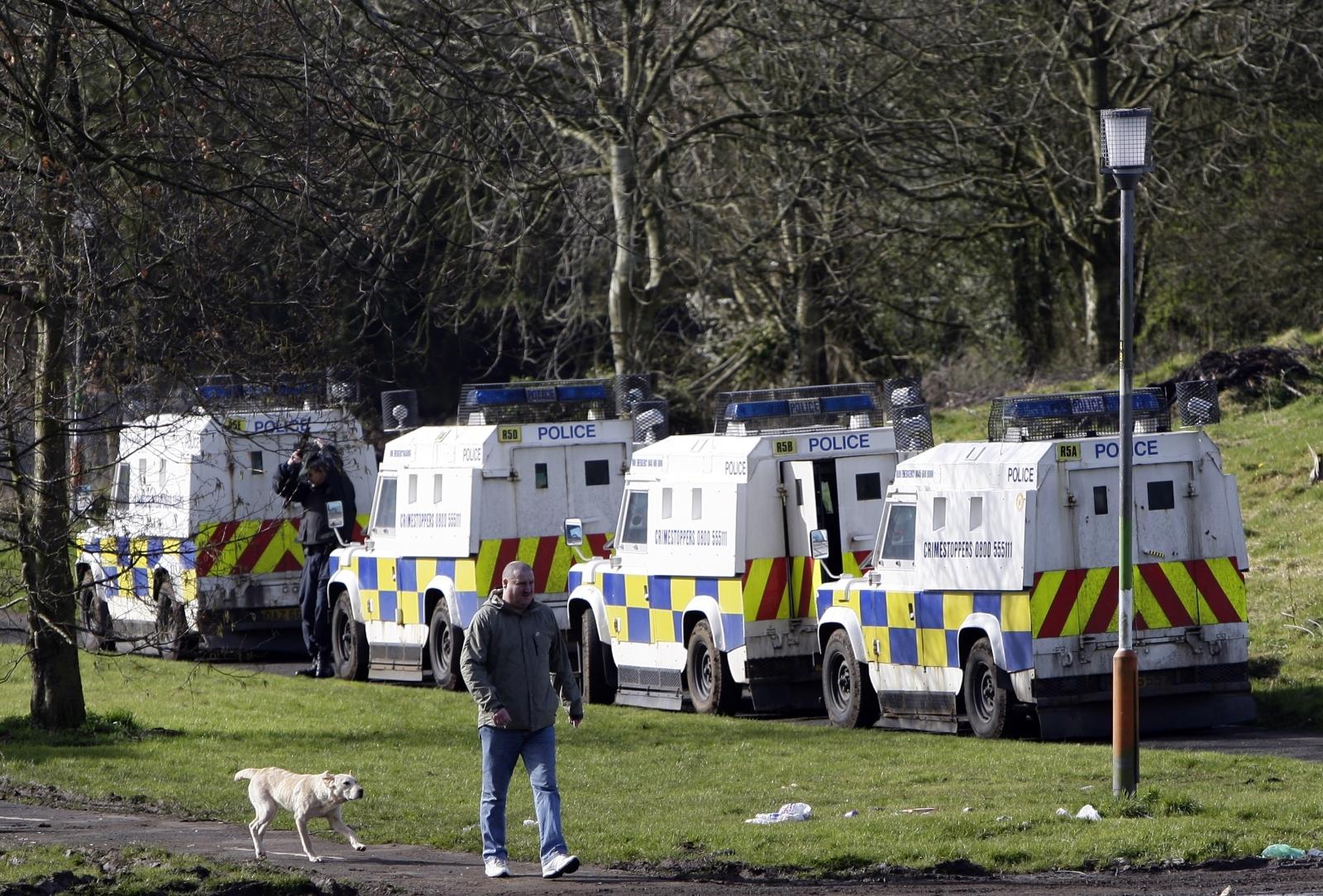 Man walks past Northern Irish police
