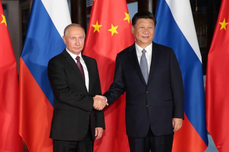 Vladimir Putin with Xi Jinping