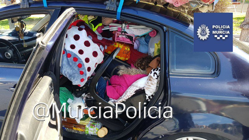 Sleeping girl in overladen car