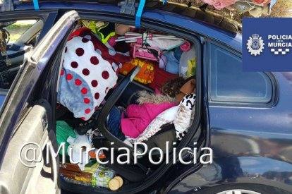 Sleeping girl in overladen car