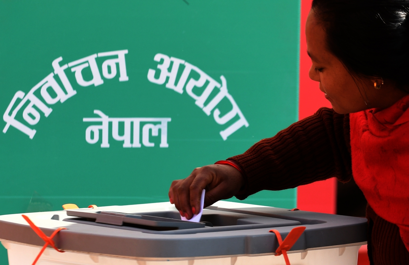 Woman votes in Nepal elections 2017