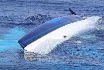 The capsized 37ft catamaran, Surf into Summer used by Bennett and his wife