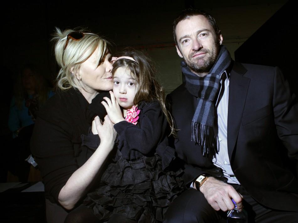 Deborra-Lee Furness, Ava Jackman, and actor Hugh Jackman attend the Edun FallWinter 2011 collection during New York Fashion Week