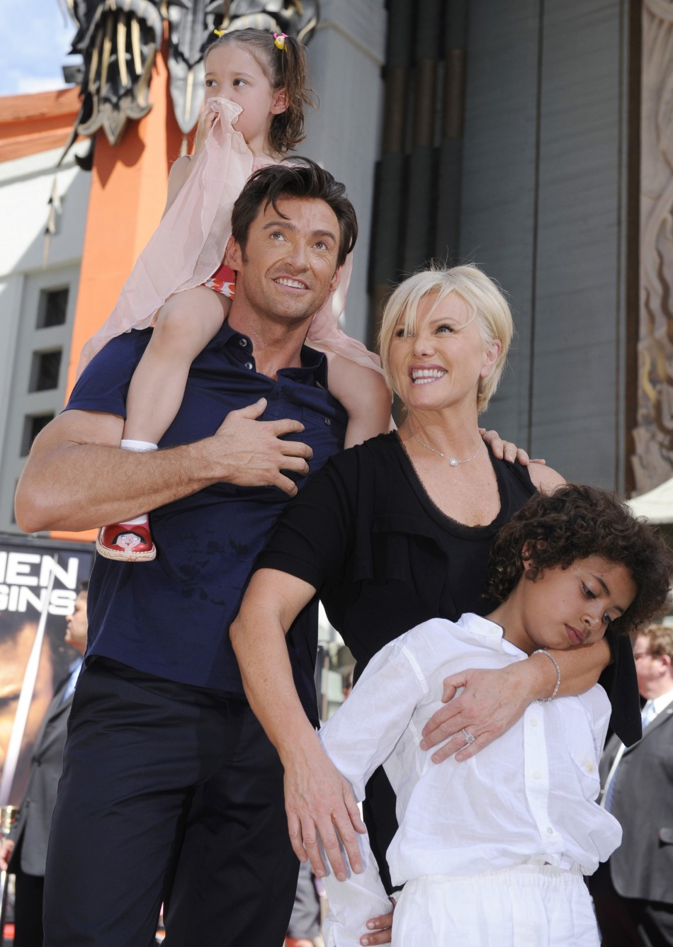 Hugh Jackman poses for photographers during a ceremony in Hollywood
