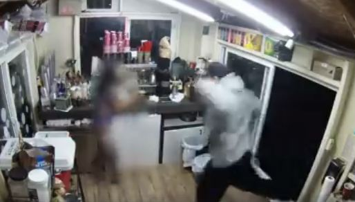 Video shows knife-wielding man trying to rape bikini barista after buying coffee from her