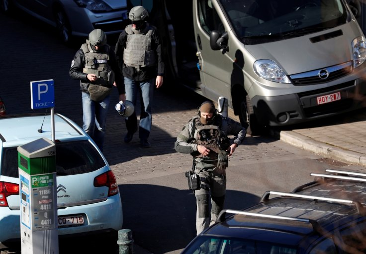 Specialist armed units prepare to surrounded a building in the Belgian capital, where a gunman, or gunmen are holed up
