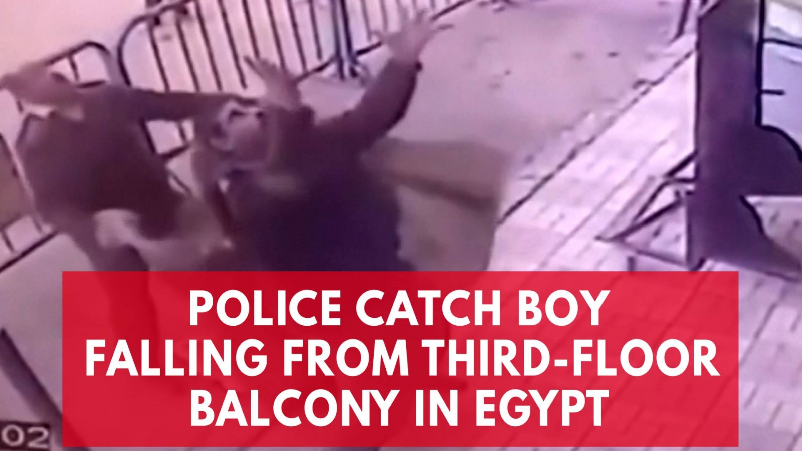 Watch: Policemen in Egypt catching a boy falling from a third-floor balcony